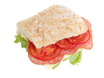 Big sandwich with salami cheese tomato and salad leaves on ciabatta bread Royalty Free Stock Photos