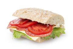 Big sandwich with salami cheese tomato and salad leaves on ciabatta bread Stock Photos