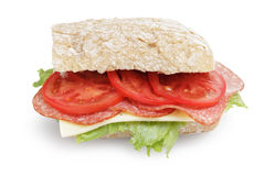 Big sandwich with salami cheese tomato and salad leaves on ciabatta bread Stock Image