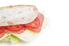 Big sandwich with salami and cheese on white bread Royalty Free Stock Image