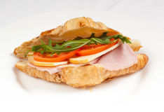 Big Sandwich With Ham And Salad On A White Plate
