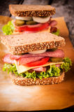 Big sandwiches. Big toast sandwiches with sausage and eggs Royalty Free Stock Image