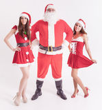 Big Santa with a hot girls, girlfriend. Big Santa with a hot girls. Santa girlfriend. Sexy babes. Christmas party 2016. Celebrating New Year 2017. Costumes Royalty Free Stock Image