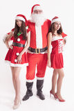Big Santa with a hot girls, girlfriend. Big Santa with a hot girls. Santa girlfriend. Sexy babes. Christmas party 2016. Celebrating New Year 2017. Costumes Stock Images