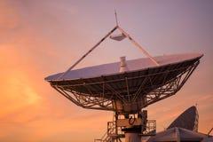 Big satelite dish at dusk. Big satelite dish or antenna against twilight sky at sunset. Telecommunication Technology concept stock photography