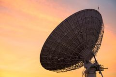Big satelite dish at dusk stock photos