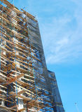 Big scaffolding construction site scaffold on blue sky perspective view Stock Photo