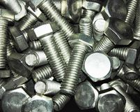 Big screws for metal construction flat lay, close up metal texture background royalty free stock photo