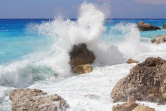 Big sea wave breaking on the shore rocks Royalty Free Stock Photos