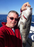 Big Seabass Selfie royalty free stock images