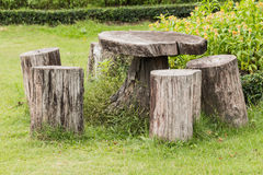 Big seat chairs made of wood trunk Stock Image