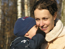 Big secret. Mother with son Stock Image