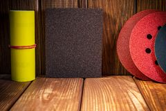 Big set of abrasive tools on vintage wood background. The wizard is used for grinding items stock photography