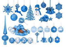 Big set of blue New Year baubles for Christmas tree. Spruce, balls, snowflakes, bells, reindeer, snowman, gift, tip, top, key isolated on white Stock Photo