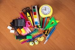 Big set of bright office supply and alarm clock Stock Photos