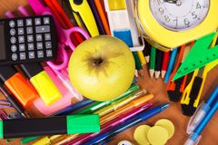 Big set of bright office supply, and an apple Royalty Free Stock Images