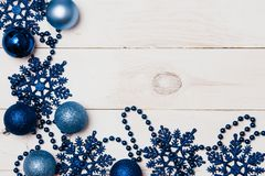 Big set of Christmas New Year ornaments, decorations, balls, snowflakes, blue beads on white on a white wooden background with stock images
