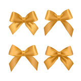 Big set of gold gift bows with ribbons. Royalty Free Stock Images