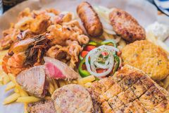 Big set Greek food Meat plate with potatoes and sauce Stock Photo