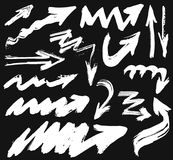 Big set with hand drawn watercolor white arrows on black background Royalty Free Stock Images