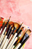 Paintbrushes and art palette Stock Photos