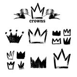 Big set of silhouettes of crowns. Black grunge icons. Painted by hand with a rough brush. Vector illustration. Isolated on white b. Ackground Royalty Free Stock Image