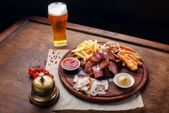 Big set of snacks for beer or alcohol and it includes smoked pork meat, french fries, fried bread, crab sticks and nuts stock photo