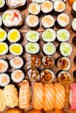 Big set of sushi and rolls on wooden table stock image