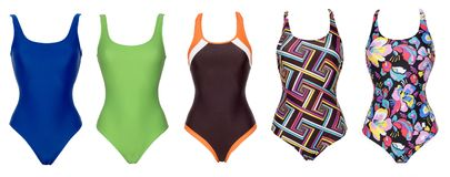 Big set of one piece swimsuits of different color royalty free stock images