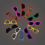 Big set 12 trendy sunglasses various colors on dark.  Stock Photo
