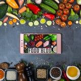 Big set of vegetables, spices and smartphone on a black background. Food blog concept. Big set of vegetables, spices and smartphone on a black background Stock Image