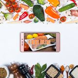 Big set of vegetables, spices and smartphone on a white background. Food blog concept. Big set of vegetables, spices and smartphone on a white background Royalty Free Stock Photo