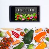 Big set of vegetables, spices and smartphone on a white background. Food blog concept. Big set of vegetables, spices and smartphone on a white background Stock Images