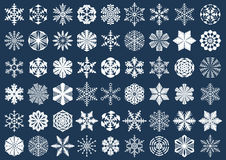 Big set of white snowflake silhouettes isolated on blue background. Winter, New Year, Christmas festive symbols. For your design. Large collection of modern Stock Photo