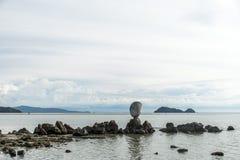 Big shell on rocks near blue ocean with beach background Koh Phangan island Thailand Stock Photography