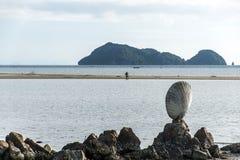 Big shell on rocks near blue ocean with beach background Koh Phangan island Thailand Royalty Free Stock Photos
