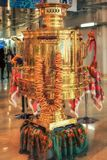 Big shining golden vintage festive Russian samovar with a bunch of bagels set out in the Olympic Mediacenter for quests to admire. Sochi, Russia - January 15 stock photography