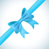 Big shiny blue bow and ribbon on white background Royalty Free Stock Images