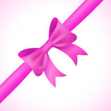 Big shiny pink bow and ribbon on white background Royalty Free Stock Images