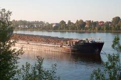 A big ship carrying wood Stock Photo