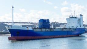 Big ship leaving harbor Stock Photos