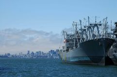 Big Ship At Port. A big ship berthed with the San Francisco skyline in background royalty free stock photos
