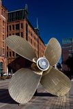 Big Ship Propeller. HAMBURG, GERMANY - OCTOBER 12, 2015: Giant four-blade ship propeller in front of the International Maritime Museum in Hamburg`s Speicherstadt Royalty Free Stock Images