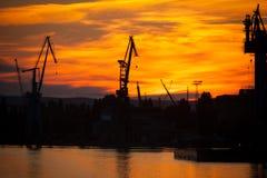 Big shipyard crane at sunset in Gdansk, Poland. Royalty Free Stock Images