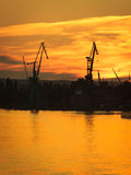 Big shipyard crane at sunset in Gdansk, Poland. Royalty Free Stock Photo