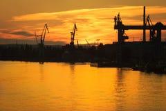 Big shipyard crane at sunset in Gdansk, Poland. Royalty Free Stock Photography
