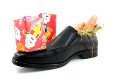 Big shoe with carrots and presents for Sinterklaas Royalty Free Stock Photos