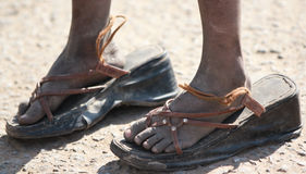 Big Shoes to Fill. In poverty stricken India Royalty Free Stock Photography