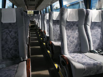 Big shuttle bus. Passenger compartment of a big shuttle bus Stock Photo