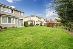 Big siding house with beautiful green backyard area Stock Image